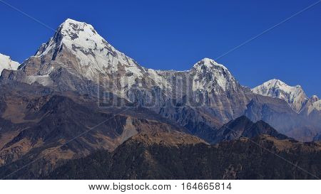 High mountains of the Annapurna Range. Annapurna South and Hiun Chuli. View from Mohare Danda.