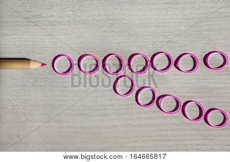 purple crayon purple rubber bands on wooden background conceptual idea teamwork