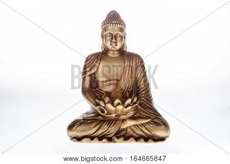 A buddha statue against a white background