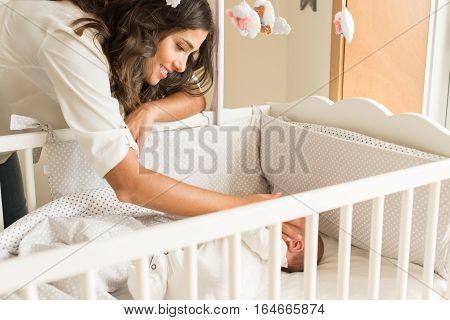 Mother Putting Baby To Sleep