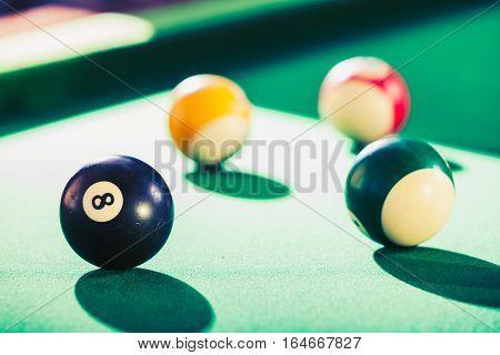 Billiard balls on green table. Pool game