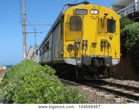 Train Passing Through The Suburb Of Fish Hoek, Cape Town South Africa,This Is Relevant And Also A Fact