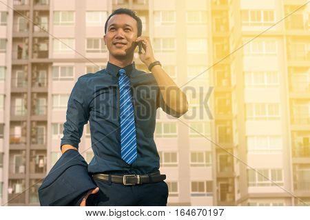 Businessman Use Digital Smartphone With Modern City Building