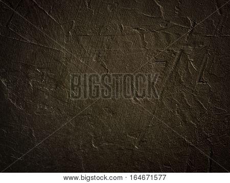 Dark grunge textured wall closeup with vignette as background