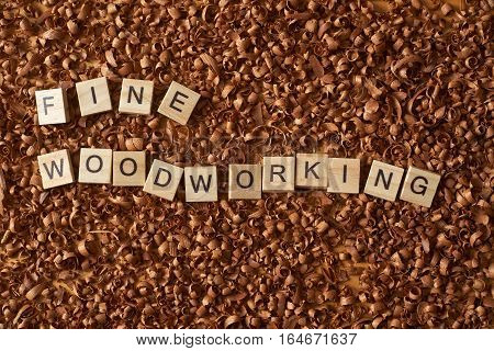 Fine woodworking word writen with letters on wood chips