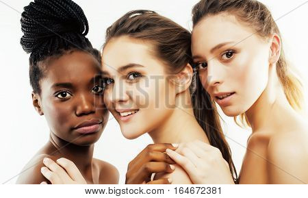 three different nation woman: african-american, caucasian together isolated on white background happy smiling, diverse type on skin, lifestyle real people concept