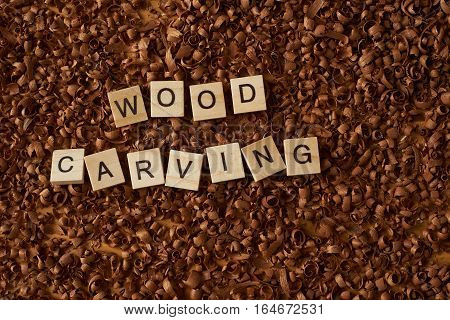 wood carving word writen with letters on wood chips