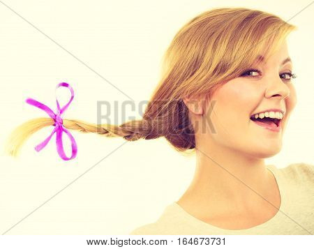 Teenage Girl In Braid Hair Making Happy Face