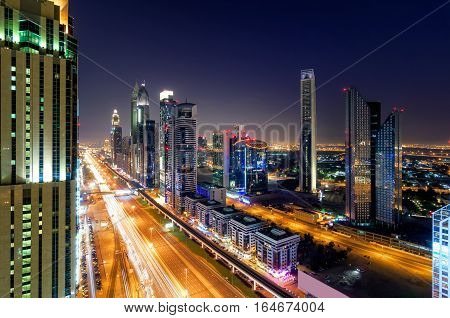 Amazing Night Dubai Downtown Skyline With Tallest Skyscrapers And Traffic Jam During Rush Hour, Duba
