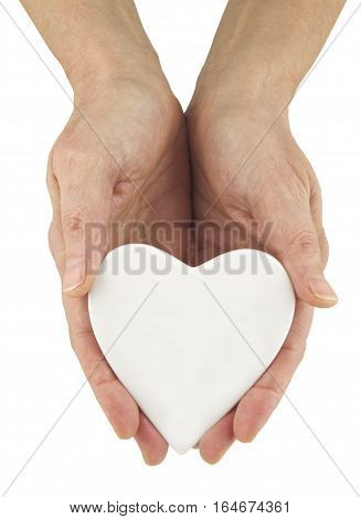 Write Your Message of Love - female hands holding a white blank heart ideal for a personal message on a white background