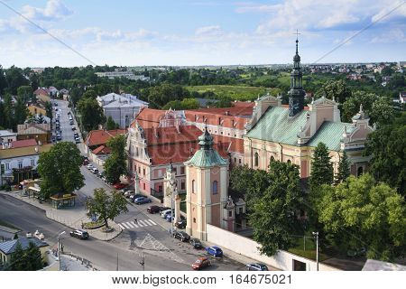 Sandomierz Poland - June 25 2011: Panorama of the city of Sandomierz. In the foreground Church of Sts. Michael the Archangel built in 1686-1692.