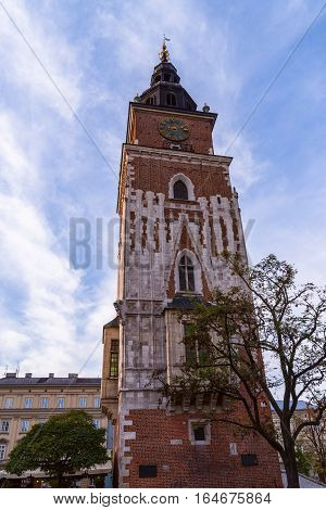 Old Tower With Stylish Big Clock. Old Town Hall In City Center Of Krakow, Poland. Former City Hall.