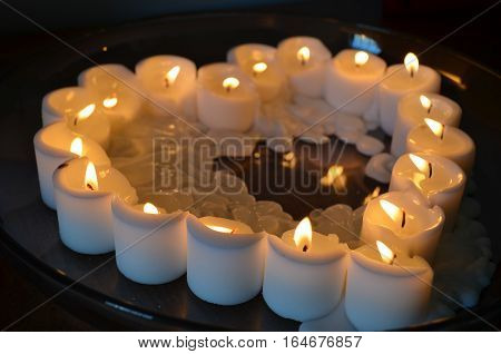 Melting white Candles in a heart shape