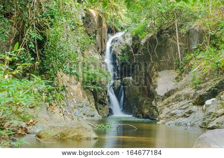 waterfall in the wild tropical jungles of Indochina