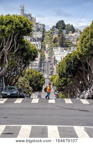 SAN FRANCISCO USA - JUNE 1 2015: People walk on the Lombard street on Russian hill San Francisco California.