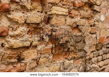 Old damaged wall. Aged bricks texture. Ruthlessness of time.