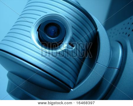 Close-up of a webcam, concept of video chatting or video conference, in blue