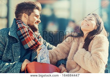 Happy young couple after a successful shopping.