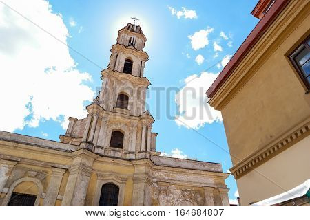 Old tower with cross. Religious building on sky background. Be closer to God.