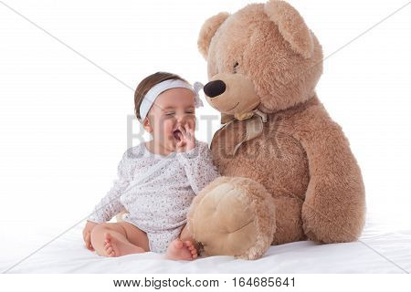 Happy Baby Playing With Fluffy Teddy Bear On White Background
