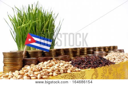 Cuba Flag Waving With Stack Of Money Coins And Piles Of Wheat And Rice Seeds