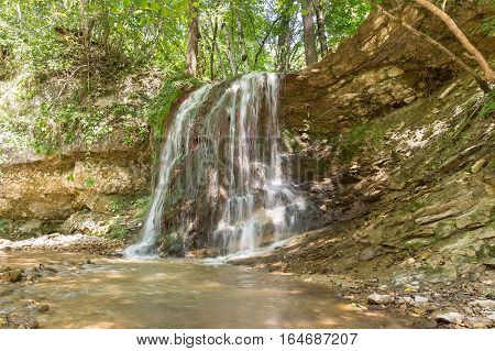 Waterfall in the forest. Russia Krasnodar Krai