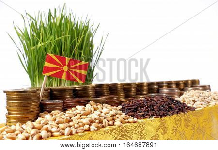 Macedonia Flag Waving With Stack Of Money Coins And Piles Of Wheat And Rice Seeds