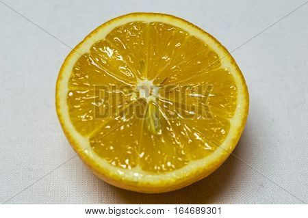 Close-up Lemon cut in half ready to wringing -squeezing isolated on white background.
