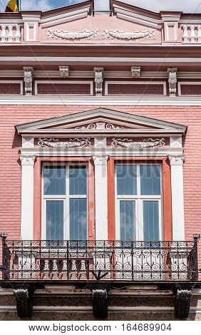 Windows with balcony, old architectural building detail