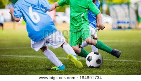 Soccer Football Match. Young Boys Kicking Football Ball on the Sports Field. Kids Playing Soccer Tournament Game on the Pitch