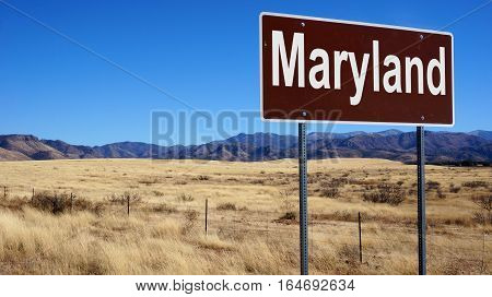 Maryland road sign with blue sky and wilderness