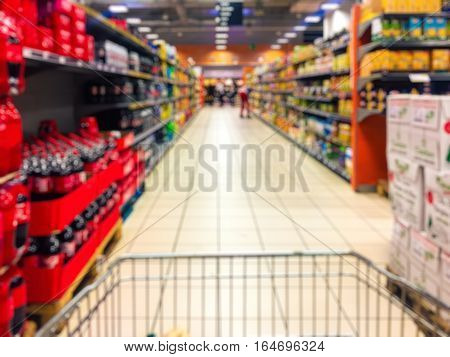 Abstract blurry supermarket interior retail and shopping mall. Concept consumism background