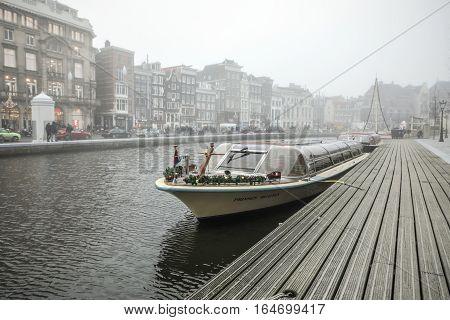AMSTERDAM NETHERLANDS - JANUARY 02 2017: Boats on water in cloudy weather. January 02 2017 in Amsterdam - Netherland.