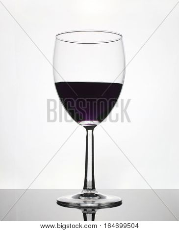 wine glass with grape juice isolated on white background