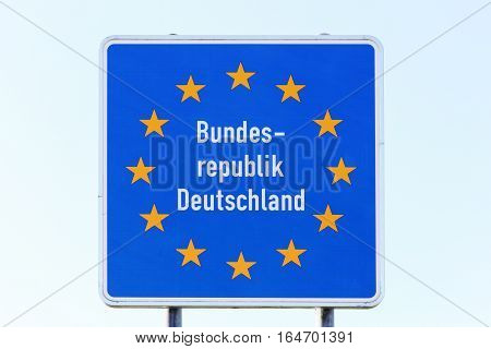 Germany border sign with a blue sky
