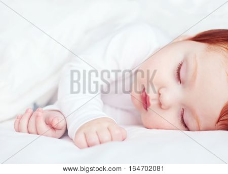 Beautiful Redhead Infant Baby Sleeping In Bed