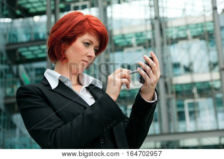 businesswoman in front of an office building