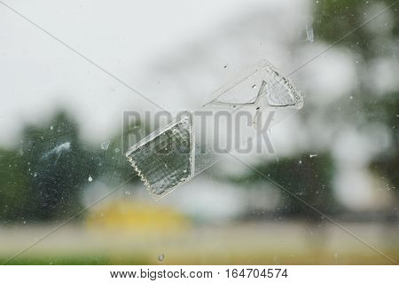 adhesive tape stain on window glass shield