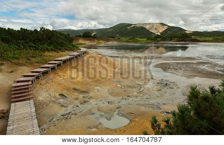 Wooden path in the Uzon Caldera. Kronotsky Nature Reserve on Kamchatka Peninsula.