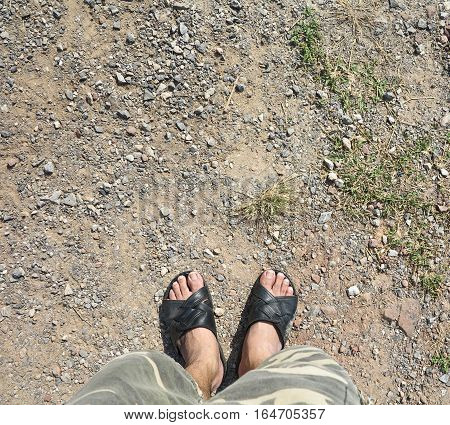 Men wear slippers shoes standing on ground look top view