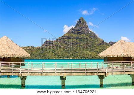 Otemanu mountain view and traditional overwater bungalow's with stunning lagoon at Bora-Bora Tahiti French Polynesia
