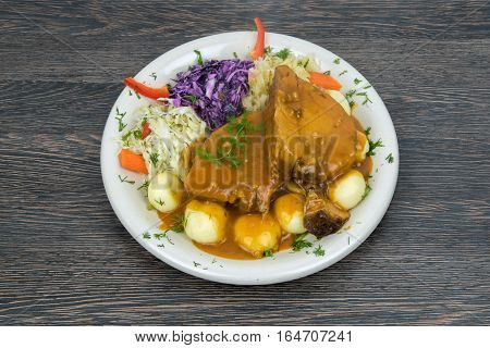 Simmered pork chops with potatoes and vegetables