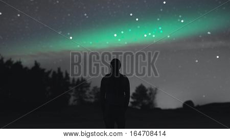 man, starry sky bokeh and the aurora