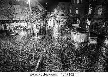 AMSTERDAM NETHERLANDS - JANUARY 02 2017: Night streets of Amsterdam with blurred silhouettes of passersby on January 02 2017 in Amsterdam - Netherland.
