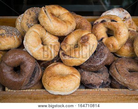 2 kinds of bagels on basket. bread