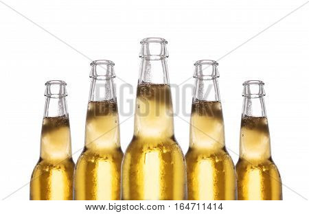 Close-up bottles of frozen lager beer, isolated on white background