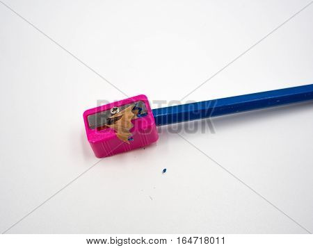 Sharpener and pencil on the white background