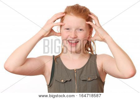 Portrait of a surprised teenage girl on white background