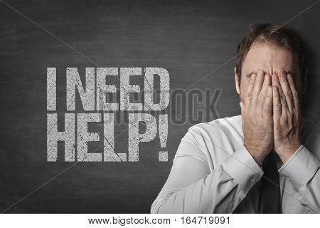 I need help on black blackboard with sad businessman