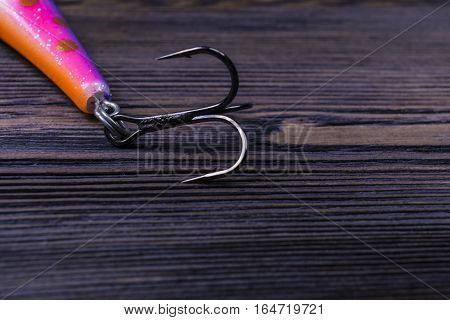 close up of fishing hook on a dark background